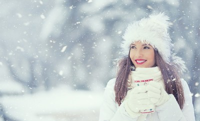 Beautiful Smiling Young Woman In Warm Clothing With Cup Of  Hot