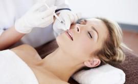 beautiful woman having botox injection
